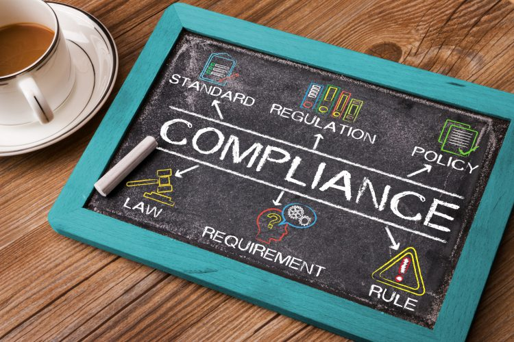Compliance concept diagram with related keywords and elements on blackboard