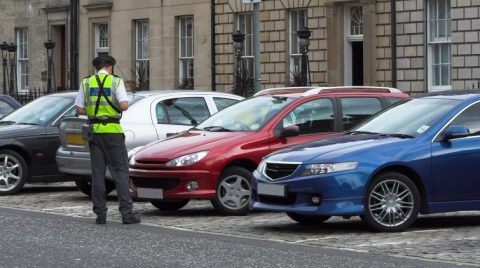 parking attendant, traffic warden, getting parking ticket, parking ticket fine mandate